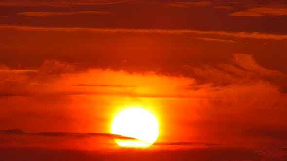 Thumbnail for Big Sun with Clouds Sunrise Timelapse
