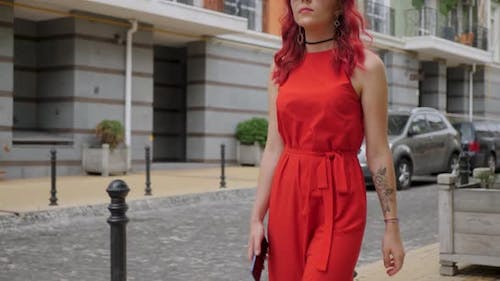Red-haired Woman in a Red Dress