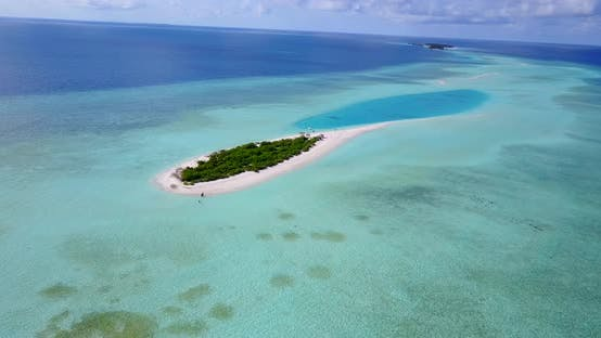 Wide angle aerial clean view of a white sand paradise beach and blue water background in colourful