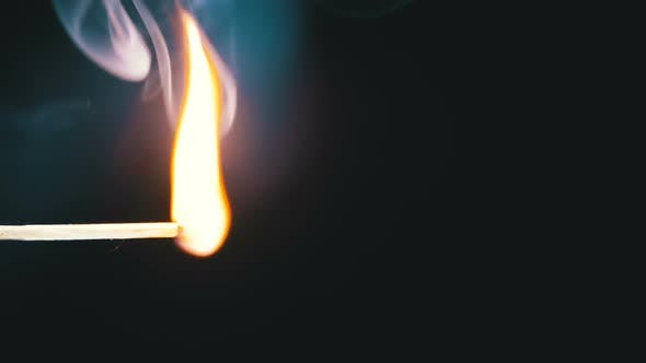 Thumbnail for Lit Match and Flame on a Black Background and Then Goes Out Creating a Lot of Smoke