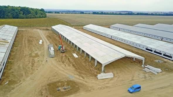 Farm construction in progress. New future building farm for livestock