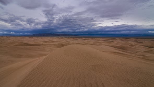 Thunderstorm in the Desert. Dramatic Sky Over Sand Dune. Timelapse