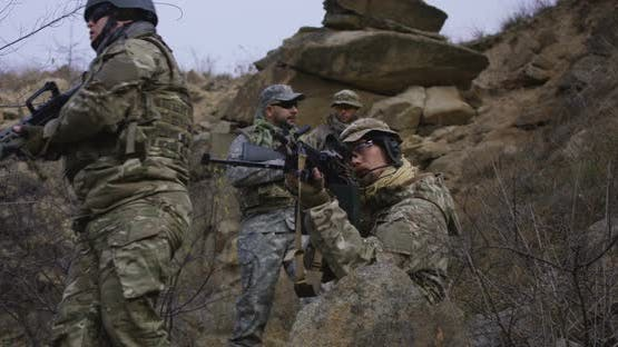 Soldier Providing Cover During Patrol