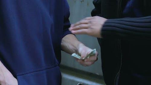 Teenager Selling Ecstasy on Street, Drug Dependency Among Children, Closeup