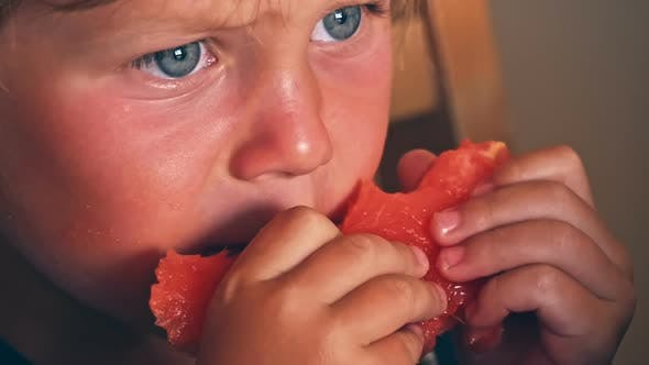 Thumbnail for Happy Child with Big Red Slice of Watermelon