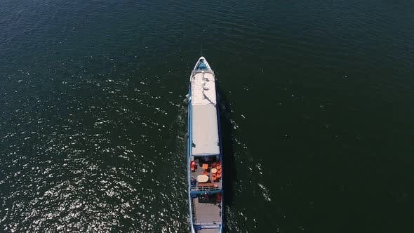 Thumbnail for Aerial Shot of a Cargo Barge Moving in the Dnipro on a Sunny Day in Summer