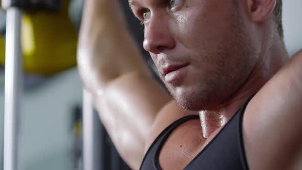 Cover Image for Determined Man Doing Shoulder Press