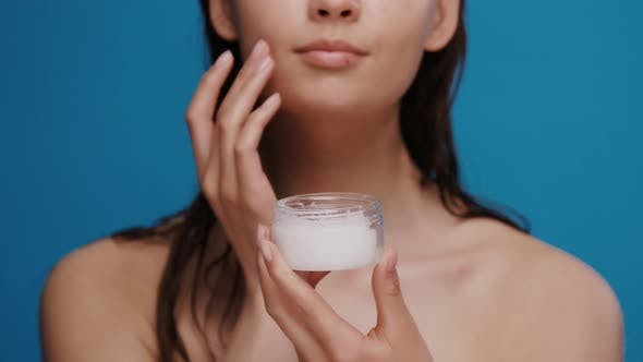 Thumbnail for Fresh Woman After Shower Moisturizing Face with White Cream