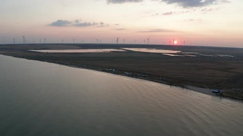 Drone View of Azov Sea and Windfarm at Sunset