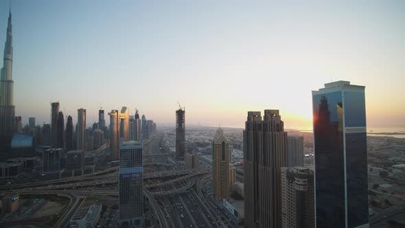 Panoramic View of Urban City Center of Dubai with Burj Khalifa Skyscraper and Busy Highway Traffic