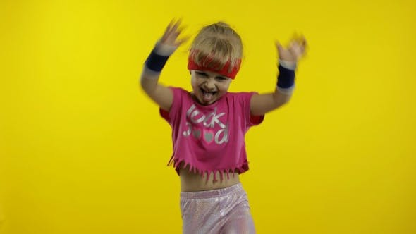 Thumbnail for Little Energetic Caucasian Girl in Pink Sportswear Making Fit Dance, Modern Aerobic Dancer