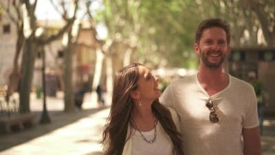 Couple in Love Walking Through Avenue