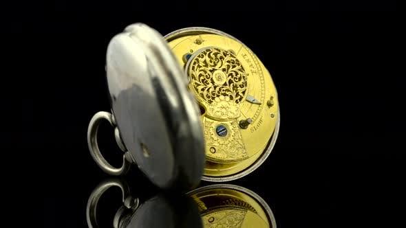 Vintage Pocket Watch Rotate. Black Background. Sound