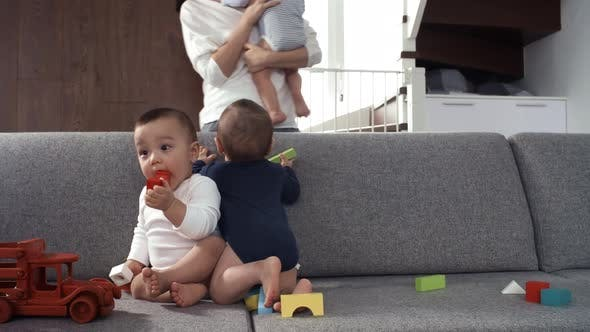 Thumbnail for Baby Brother Joining his Twin Siblings on Couch