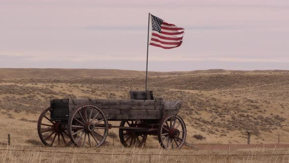 Wyoming History American Flag on Wagon Pioneer Settler in Great Plains
