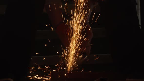 Cutting Steel with Angle Grinder in Workshop
