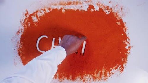 Hand Writes On Chilli Chili