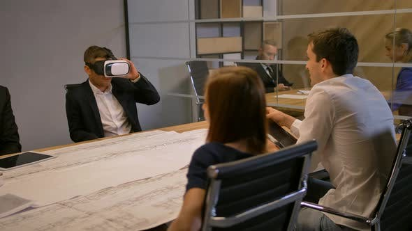 Employee and His Colleagues Working with VR Future Technology Concept and Drawing