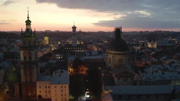 Flight Above the Roofs on Sunrise. Old European City. Ukraine Lviv City