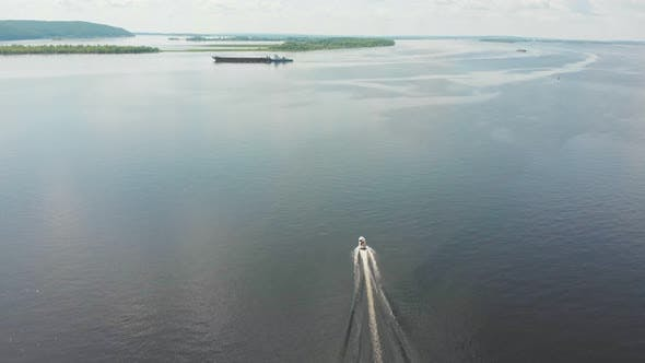 Thumbnail for Motor Boat on River and Barge Passing By - Green Islands on the Water