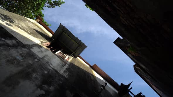 Slowly rotate and look up the old building roof