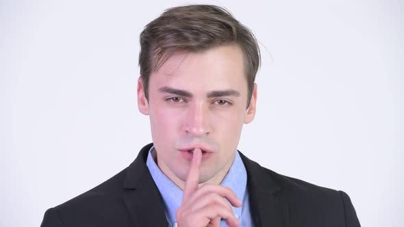 Thumbnail for Young Happy Handsome Businessman with Finger on Lips