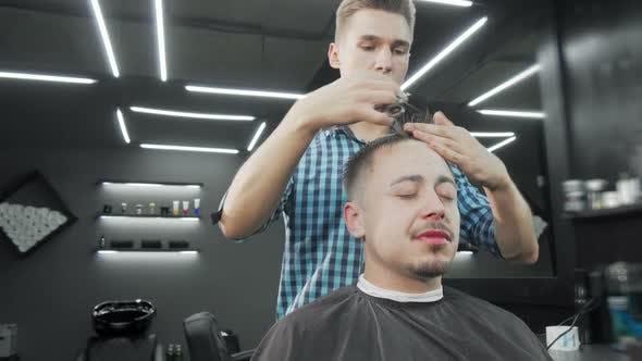 Thumbnail for Mature Man Getting a Haircut at the Barbershop
