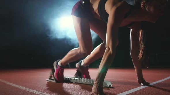 Thumbnail for Female Athlete on a Dark Background Is Preparing To Run the Cross-country Sprint
