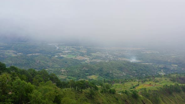 The Rainy Clouds Covered the Top of Green Forest Mountain. Rain Clouds in a Tropical Climate.