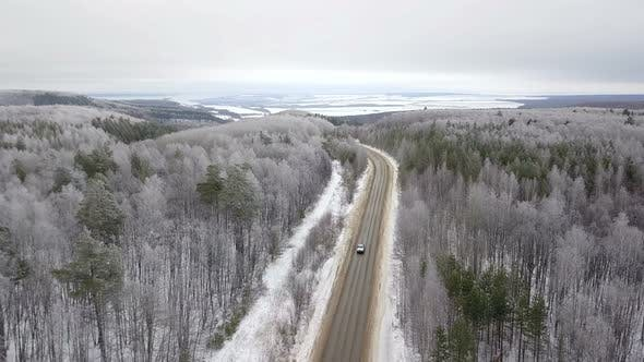 Thumbnail for Car On The Winter Forest Road