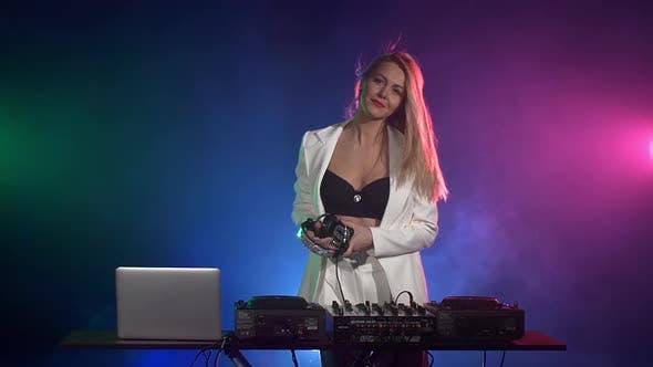 Thumbnail for Beautiful Dj Girl in White Jacket, Headphones Playing Music and Dancing, Smoke, Flipping Hair, Slow