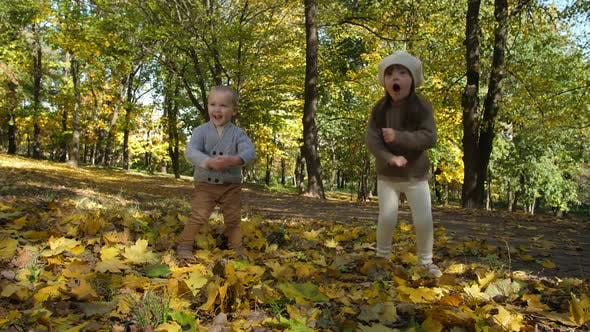 Thumbnail for Cute Funny Little Kids Dancing in Autumn Park