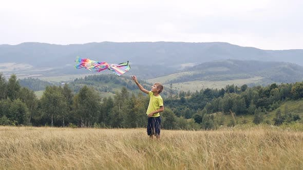 The Boy Runs and Launches a Snake in the Mountains