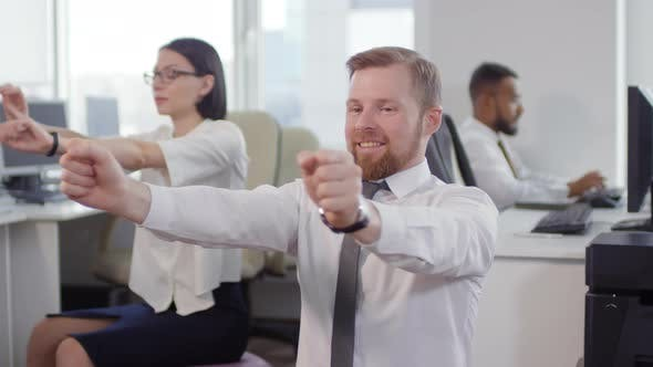 Thumbnail for Business Colleagues Exercising at Workplace