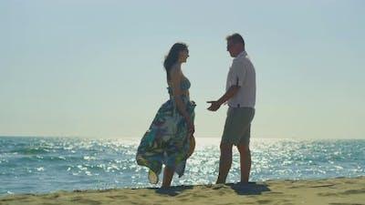 Pair standing on beach