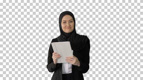 Arabian businesswoman in hijab using tablet, Alpha Channel