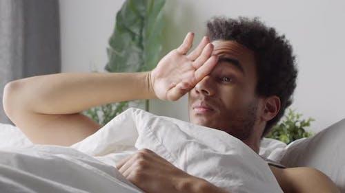 Black Man Waking Up Early
