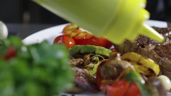Thumbnail for Adding Sauce to Beefsteak with Grilled Vegetables