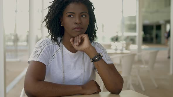 Thumbnail for Thoughtful African American Woman Sitting at Cafe