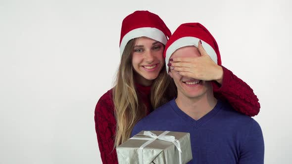 Gorgeous Woman Giving Christmas Surprise To His Handsome Boyfriend