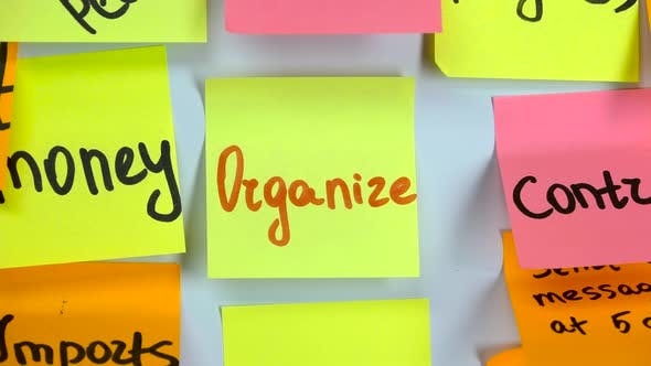 Thumbnail for Sticker with the Word Organize Stick on a White Board