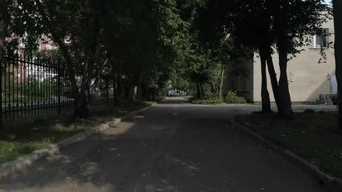 Drone view of asphalt road near preschool building 26