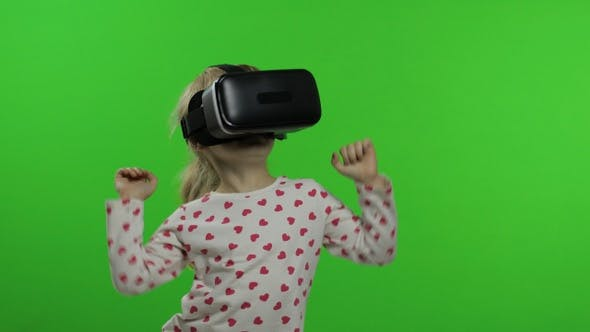Cover Image for Child Girl Using VR Headset Helmet To Play Game. Watching Virtual Reality 3d 360 Video. Dancing