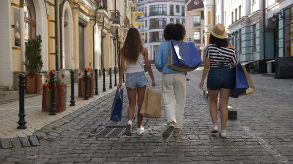 Thumbnail for Back View of Three Diverse Shopper Females Walking