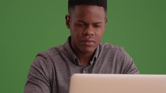 Thumbnail for Young black man working on a laptop on green screen