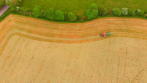 Thumbnail for Heavy agriculture machine tractor ploughing the field 4k
