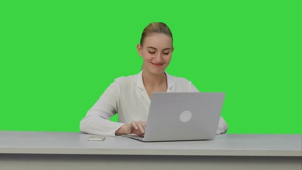 Thumbnail for Happy Businesswoman Enjoy Working on Laptop Computer, Imagine the Project and Write Down