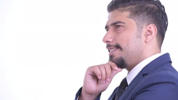 Thumbnail for Closeup Profile View of Happy Bearded Persian Businessman Thinking