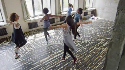 Young Women Dancing Zumba