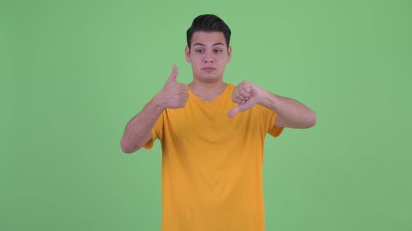 Thumbnail for Happy Young Multi Ethnic Man Giving Choosing Between Thumbs Up and Thumbs Down